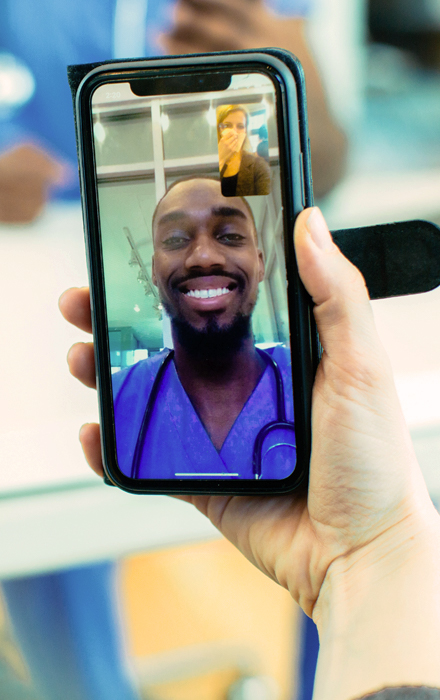 doctor uses mobile video conferencing to deliver patient care